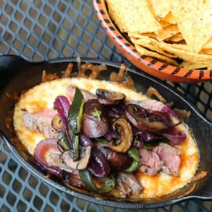 TEC Grills Flank Steak with Cheese Sauce and Rajas