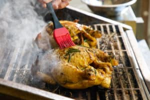 TEC Grills Pomegranate and Citrus Smoked Cornish Hens - Glazing the Cornish Hens