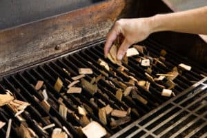 TEC Grills Pomegranate and Citrus Smoked Cornish Hens - Adding Wood Chips to the Grates of the G-Sport